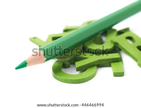 Pile of painted wooden letters with the drawing pencil over it, composition isolated over the white background - stock photo