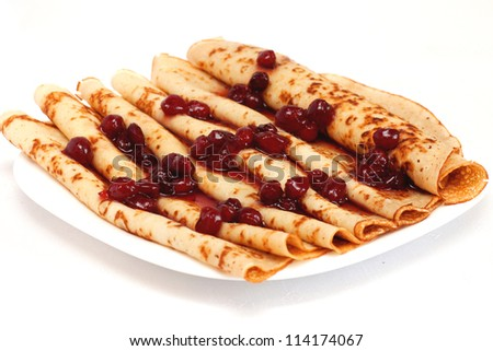 pile of pancakes with cherry jam