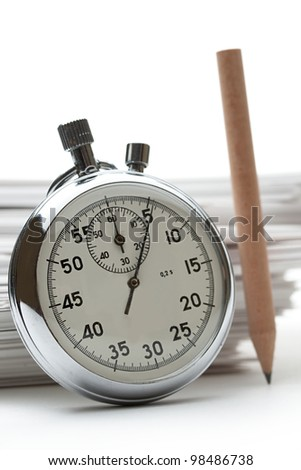 Pile of paper cards with pencil and stopwatch - stock photo