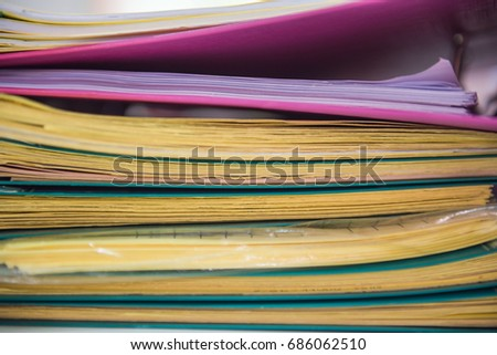 Pile of paper files  documents on work desk in office ,  business paper .