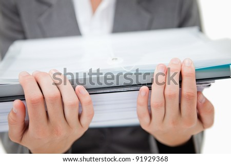 Pile of paperwork being held by female hands against a white background - stock photo