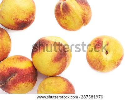 Pile of peach fruits isolated over the white background - stock photo