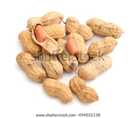 Pile of peanuts with leaf, isolated on white