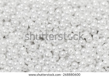Pile of pearl on the white background - stock photo