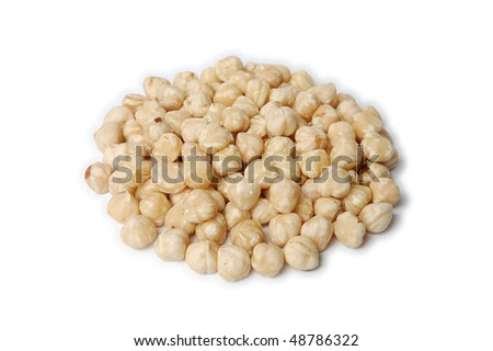 Pile of peeled (blanched) hazelnuts isolated on white - stock photo