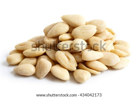 Pile of peeled whole almonds isolated on white.