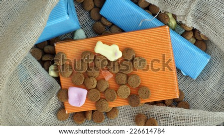 Pile of Pepernoten and presents, typical Dutch treat for Sinterklaas on 5 december - stock photo