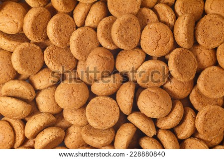Pile of pepernoten, ginger nuts. A dutch treat for Sinterklaas celebration on 5 december. Event in Holland, Netherlands. - stock photo