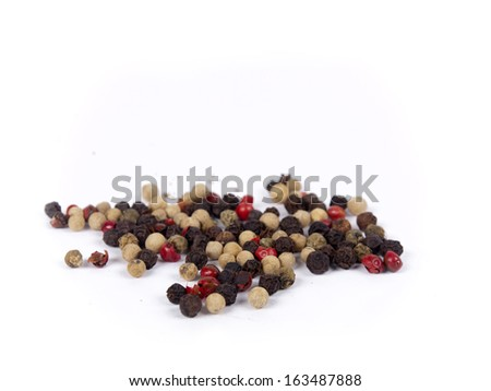 Pile of peppercorn isolated over white - stock photo