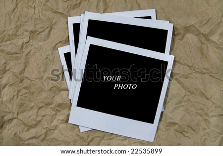 Pile of Photographs on Crumpled Paper
