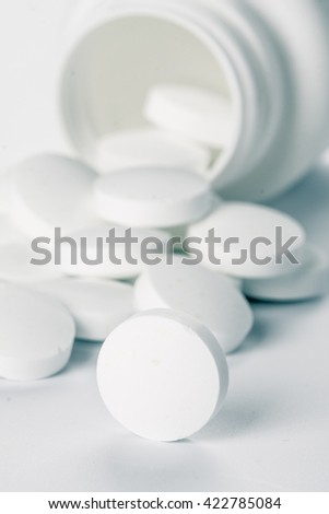Pile of pills toned. Medical background