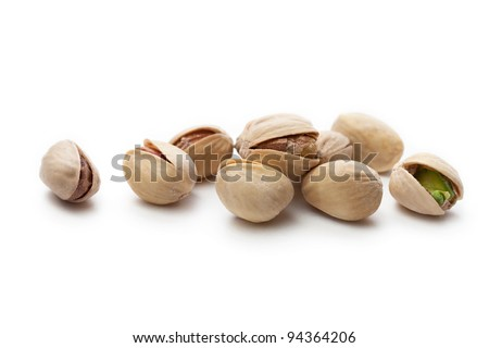 Pile of pistachios on white
