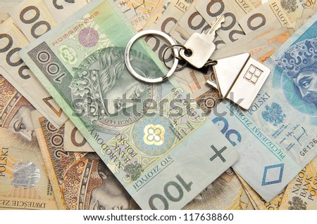 Pile of Polish money and a key for the house