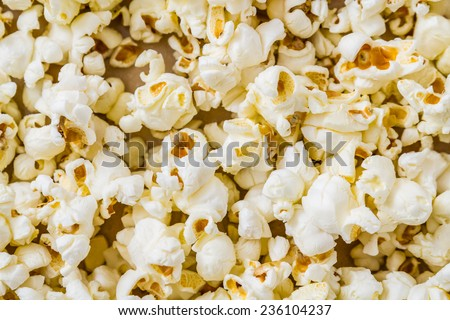 Pile of popcorn on wooden white background