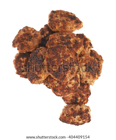 Pile of prepared small hand made cutlets isolated over white background - stock photo