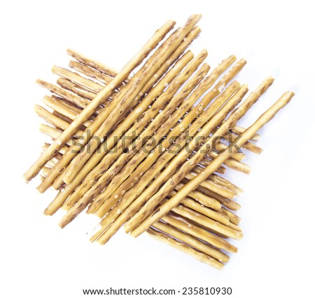 pile of pretzel sticks on white background. - stock photo
