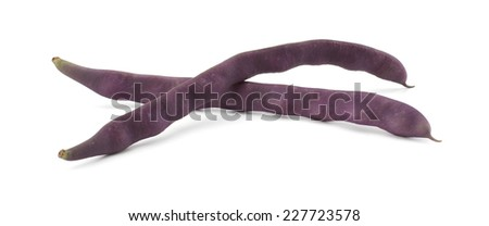 Pile of purple string beans isolated on white - stock photo