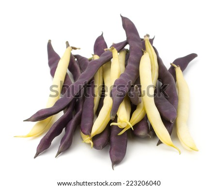 Pile of purple string beans isolated on white background - stock photo