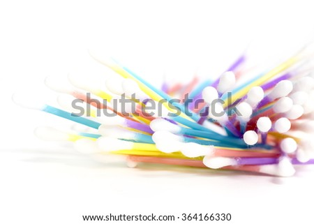 pile of Q tips on a white background - stock photo