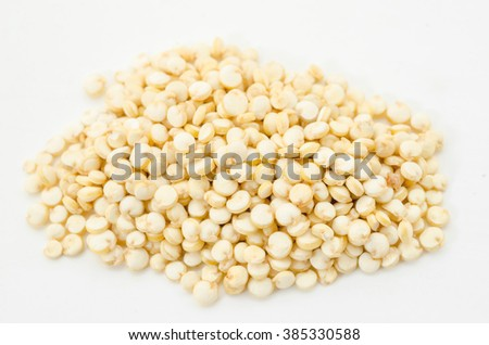 Pile of quinoa grain on a white background - stock photo