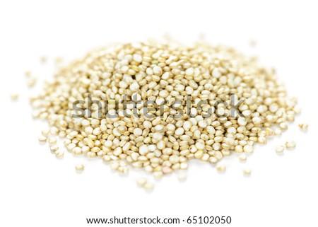 Pile of quinoa grain on white background - stock photo