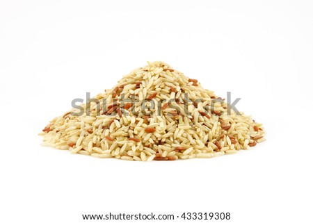 Pile of raw brown rice, white background