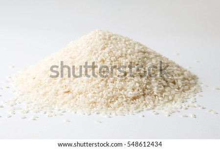 Pile of raw rice on white background