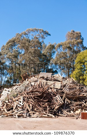 Pile of raw timber for recycling - stock photo