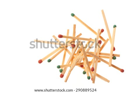Pile of red and green wooden matches isolated on white background - stock photo