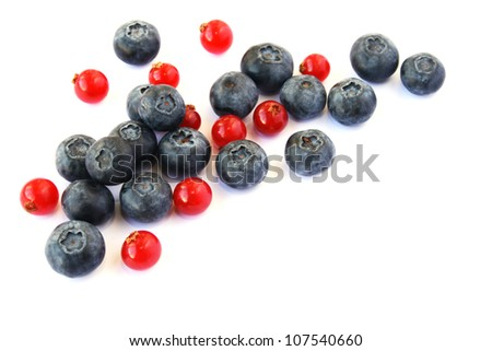 Pile of  red currants, blueberries isolated on white background.
