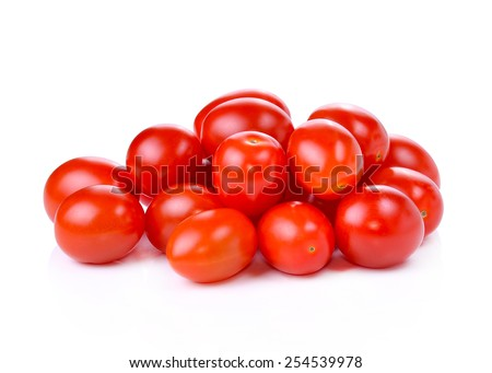 Pile of red grape tomatoes isolated on white background - stock photo