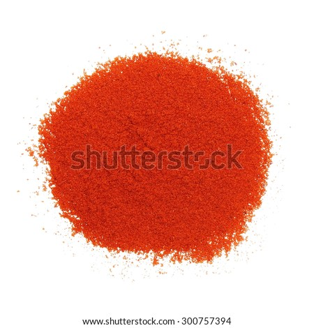 Pile of red paprika powder isolated on white - stock photo