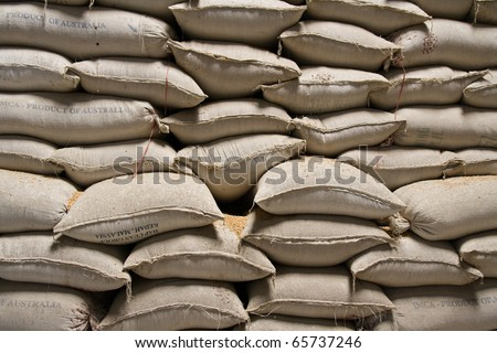 Pile of rice sacks in grain warehouse, Vietnam