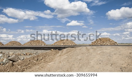 Pile of rock for road construction - stock photo