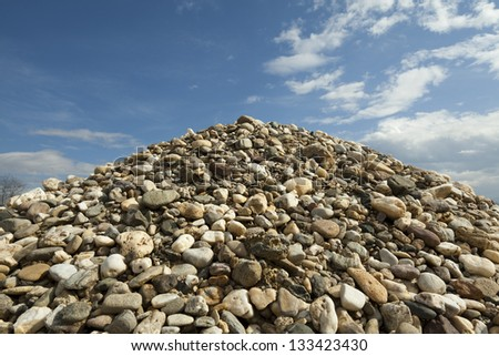Pile of rocks and blue sky - stock photo