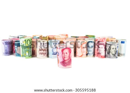 Pile of rolled-up currency notes with China Yuan Renminbi in front. - stock photo
