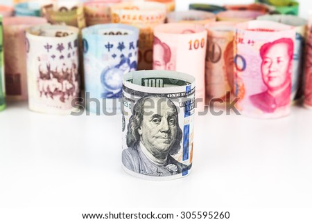 Pile of rolled-up currency notes with US Dollar in front. - stock photo