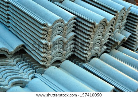 Pile of Rooftop Tiles on a Construction Site - stock photo