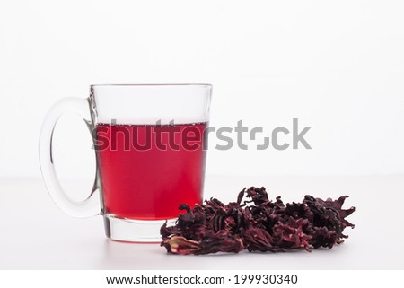 pile of Roselle and juice on white background  - stock photo