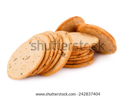Pile of round cookies isolated on white background.