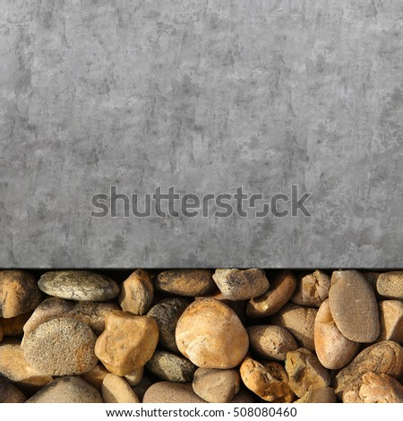 Pile of round pebble stones and cement floor