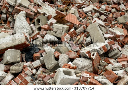 Pile of rubble composed of bricks and cinder block.