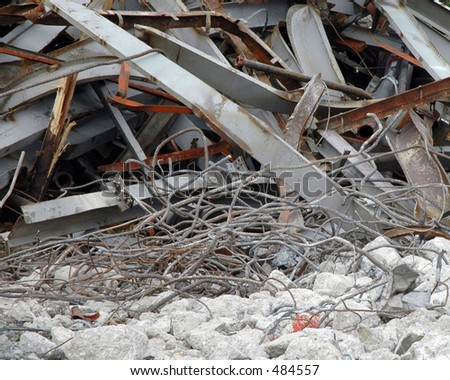 Pile of rubble from demolished building containing twisted steel and broken concrete - stock photo