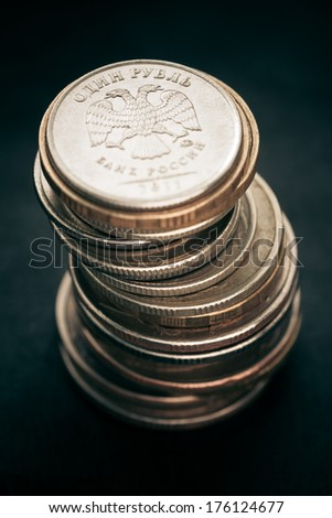 Pile of russian coins on a dark background. Selective focus with shallow depth of field. Color toned image.