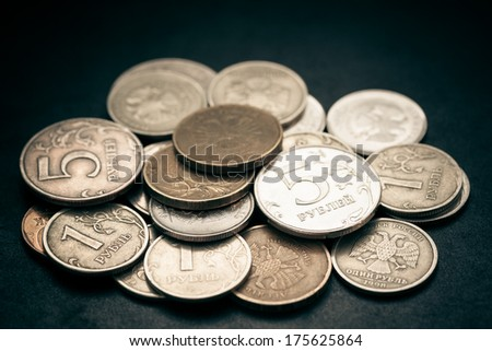 Pile of russian coins. Selective focus with shallow depth of field. Color toned image. - stock photo