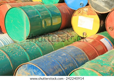 Pile of rusty fuel and chemical drums - stock photo