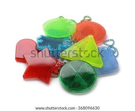 Pile of safety reflectors isolated on white - stock photo