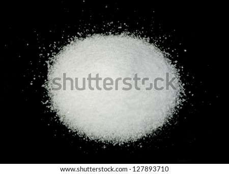 Pile of salt on black background . - stock photo