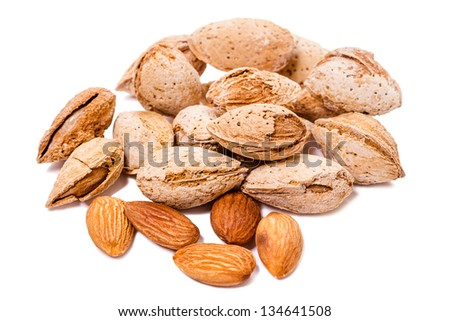 Pile of salted almonds in the shell on  white - stock photo