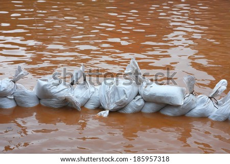pile of sandbags in defense from the water during the flood - stock photo